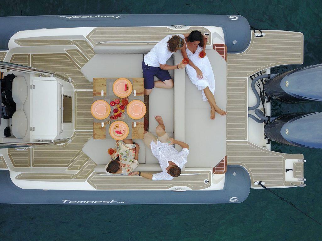 Friends enjoying sailing on boat